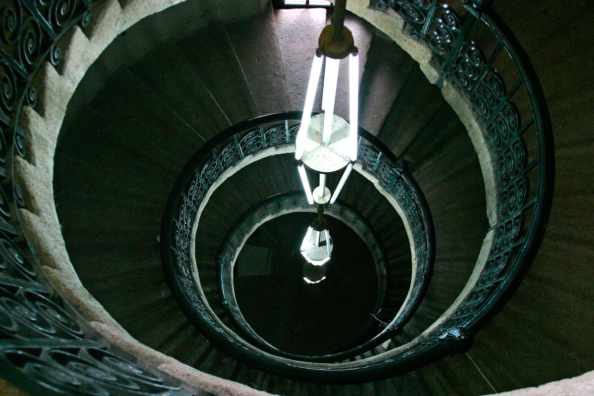Circular stone and wrought iron staircase inside the monastery of Montserrat, Catalonia, Spain.